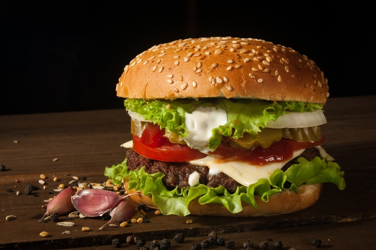 a burger on a wooden table