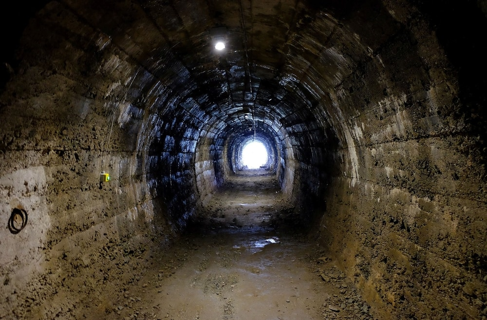 Rounded tunnel with light at the end
